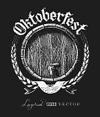 Oktoberfest lettering with wooden barrel