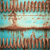 Old blue and rusted metal springs textured background