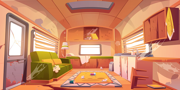 Old dirty interior of camper with broken furniture