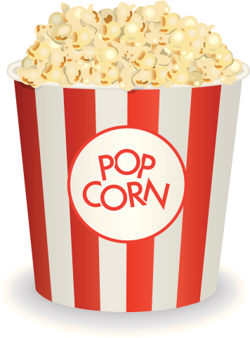 Old fashioned red and white popcorn bucket overflowing