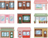 A set of old fashioned store fronts with a variety of subjects: A florist, boutique, pet store, candy shop, antiques dealer, bakery, barber, and wine shop. File contains no gradients.