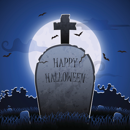 Old gravestone at night with happy halloween word in cemetery