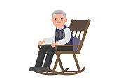 Old man sitting on rocking chair.
