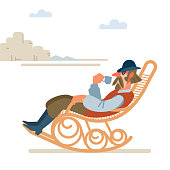 istock Old successful cowboy resting with a Cup of coffee in a rocking chair. wild West. Cartoon vector illustration. Flat style. Isolated on white background 1211279674