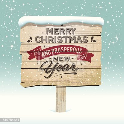 istock Old vintage wooden Christmas sign in the snow 519764631