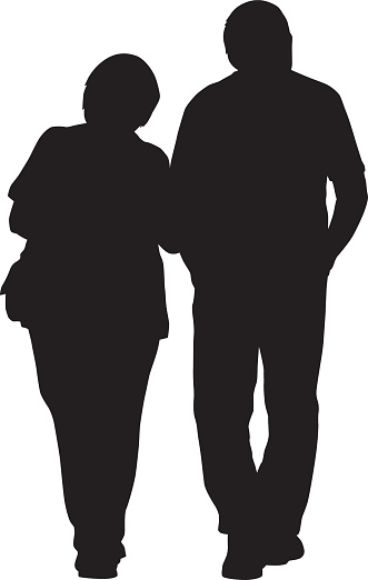 Older couple Walking Arm In Arm