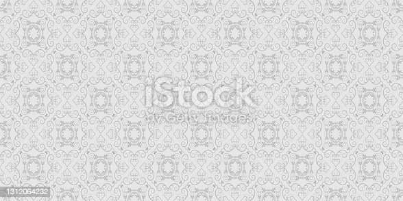 istock Old-fashioned background pattern with floral ornaments on a gray background, vintage 1312064232