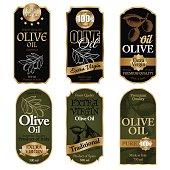 Set of black and green olive oil labels on white background vector illustration