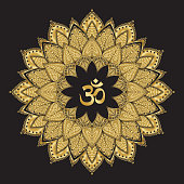 Om symbol with mandala. Round golden Pattern on black background. Hand drawn Ornate Indian pattern decorative vector elements.