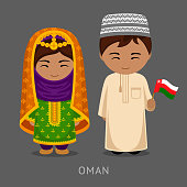 Omani in national dress with a flag.
