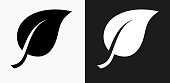 One Leaf Icon on Black and White Vector Backgrounds. This vector illustration includes two variations of the icon one in black on a light background on the left and another version in white on a dark background positioned on the right. The vector icon is simple yet elegant and can be used in a variety of ways including website or mobile application icon. This royalty free image is 100% vector based and all design elements can be scaled to any size.