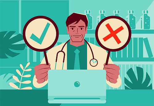 One mature doctor using a laptop providing telemedicine services holding an OK sign and NO sign