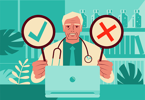 One senior doctor using a laptop providing telemedicine services holding an OK sign and NO sign