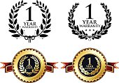 One year warranty medals with laurels.