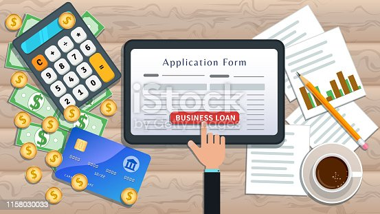 923038914istockphoto Online business loan or lending concept. Home mortgage. Flat tablet with loan application form and hand click button on desk with cash, calculator, credit card, pencil, cup of coffee, chart 1158030033