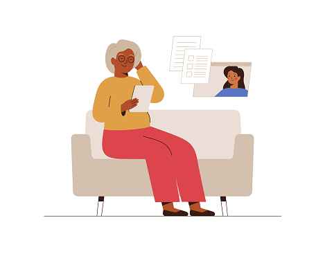 Online Doctor or Medical Service concept. African senior woman has a video consultation on health issues with her doctor or Social Worker.
