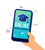 Online education with mortarboard and smartphone concept.