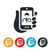 An icon of a hand holding a smartphone with a doctor on the screen. The icons represents the increasing popularity of online healthcare visits between doctors and their patients.