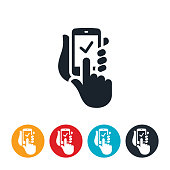 An icon of a hands holding a smartphone. One hand clicks on the screen adding a checkmark to indicate an online order from a smartphone.