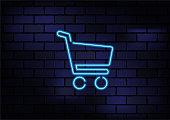 istock Online Shopping Sign Blue Neon Light On Dark Brick Wall 1214915680