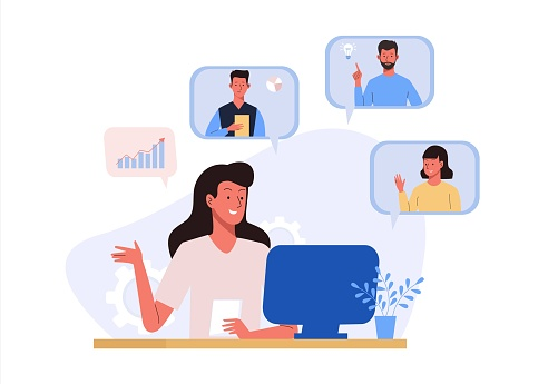 Online video conference with colleague. Woman at home with computer