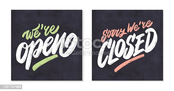 istock Open and closed signs. We're open. Sorry, we're closed. 1257797989