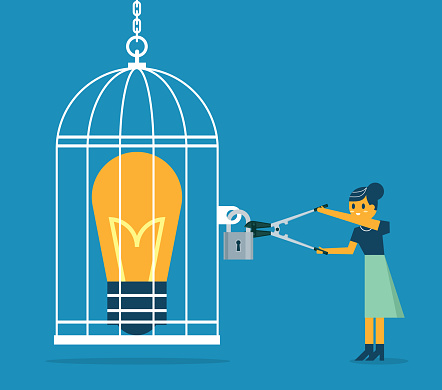 Open cage with idea bulb - Businesswoman