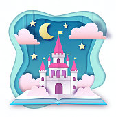 Open fairy tale book with castle with clouds, stars and moon. Cut out paper art style design. Origami