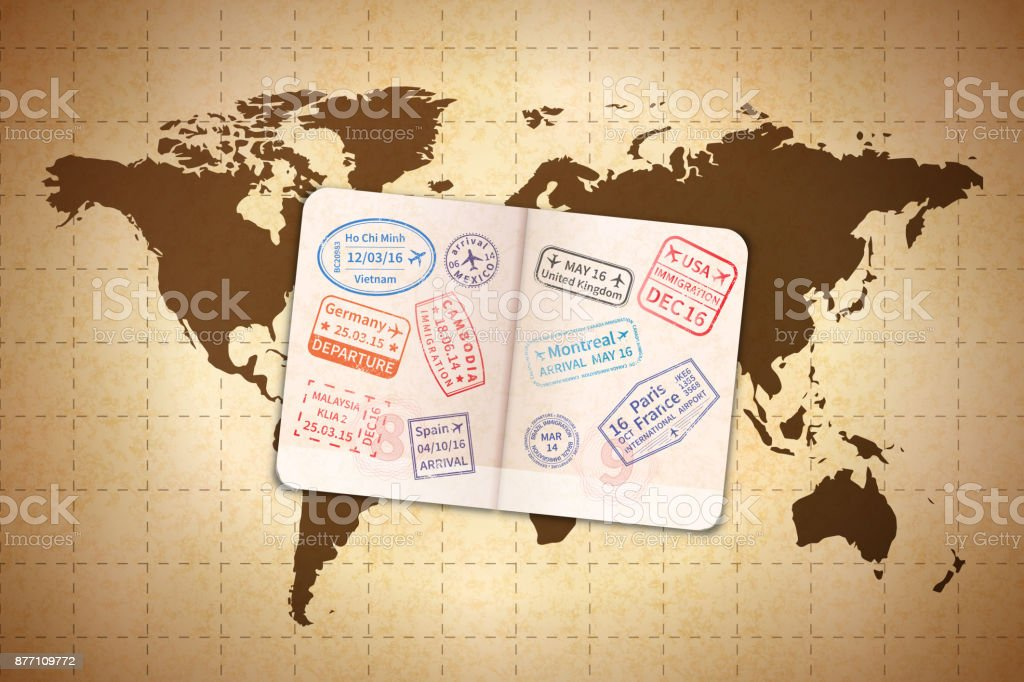 Open foreign passport with international visa stamps on ancient open foreign passport with international visa stamps on ancient world map on old textured paper royalty gumiabroncs Gallery