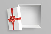 Open gift box vector illustration. Opened square surprise box with red bow and ribbon isolated on grey background. View from above. Element for your design. Eps 10,