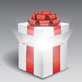 Open gift box with bright light