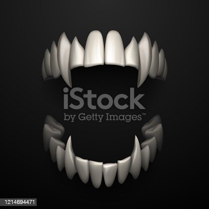 istock Open jaws with big fangs on black background 1214694471