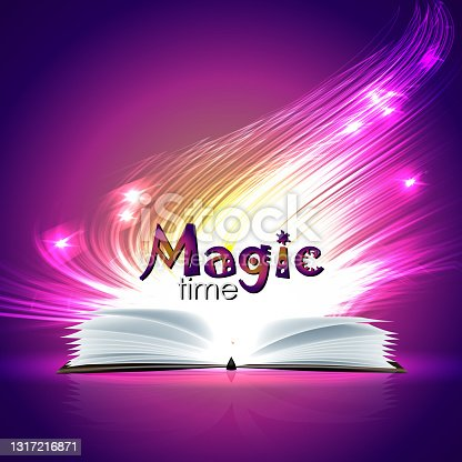 Open magic book and a wand with bright lights.