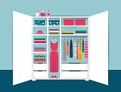Open wardrobe. White closet with tidy clothes