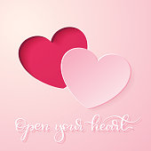 """A paper heart cut out. Hand lettered phrase """"open your heart"""" on a soft pink background. Design element for holiday cards, invitations, anniversaries...  EPS10 vector illustration, global colors, easy to modify."""