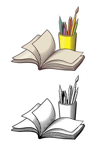 Opened book and pencils in a cup