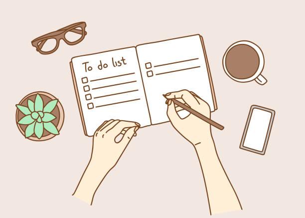 illustrazioni stock, clip art, cartoni animati e icone di tendenza di opened personal organizer with a to do list. top view of women hands writing goal to do list - to do list