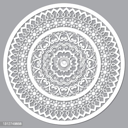 istock Openwork mandala vector mandala styled as Moroccan wood panels, round arabic pattern in white on gray background 1312749858