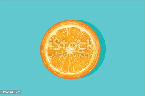 Fresh orange cut in half on a blue background