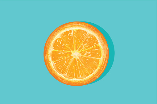 Fresh orange cut in half on a blue background