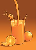 Orange juice splashes into a glass. Are you feeling thirsty?