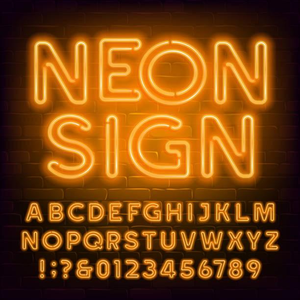 pomarańczowa neonowa czcionka alfabetu. retro lekkie litery bąbelkowe i cyfry na tle ceglanej ściany. - neon stock illustrations