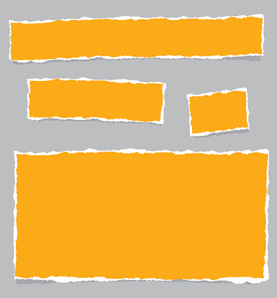 Orange paper pieces on a grey background
