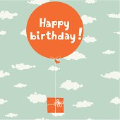 Air balloon with gift in the sky. Happy birthday lettering on the balloon. Seamless cloud background.