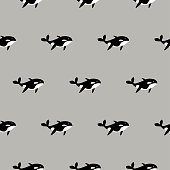 Orca whale seamless vector pattern. Cartoon style black and white fish background.