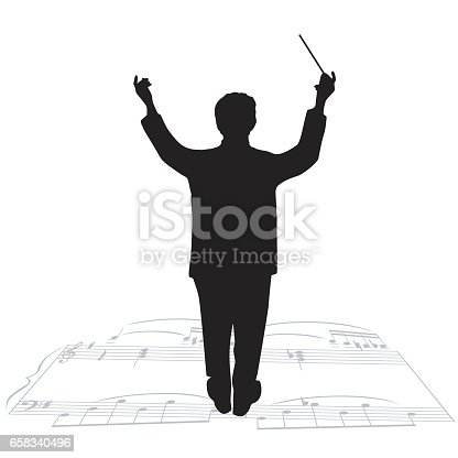 A vector silhouette illustration of an orchestra conductor with arms raised and baton in hand standing on sheet music.