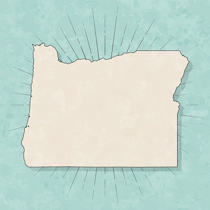 Map of Oregon in a trendy vintage style. Beautiful retro illustration with old textured paper and light rays in the background (colors used: blue, green, beige and black for the outline). Vector Illustration (EPS10, well layered and grouped). Easy to edit, manipulate, resize or colorize.