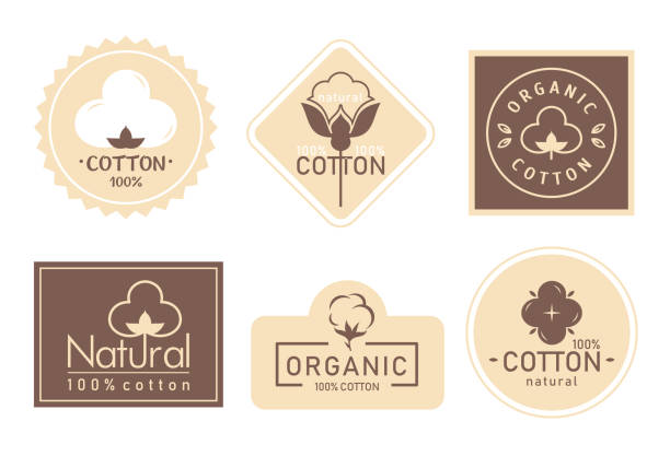 Organic cotton label vector illustration set, mark logo icons collection with cottonseed branch plant symbol emblem, natural bio organic product Organic cotton label vector illustration set. Mark logo icons collection with cottonseed branch plant symbol emblem, natural bio organic product, fabric quality fiber for knitting and textile industry cotton stock illustrations