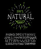 Organic handwritten font NATURAL. Hand crafted typeface design. Original handmade alphabet type on black background. Isolated doodle vector letters and numbers. Ecology template badge.