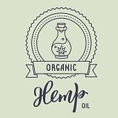 Organic hemp oil. Modern calligraphy hand lettering and label with bottle  oil. Vector illustration for logo, poster, label, print and web project.